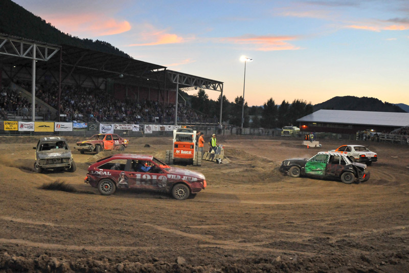 07/28/13 - The number 1313 Local Restaurant & Bar car is chased by the number 1 Thai Me Up Restaurant and Brewery car during the Figure 8 Races at the closing night of the 2013 Teton County Fair. Photographer: